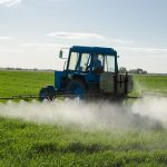 ractor spray fertilize field with insecticide herbicide